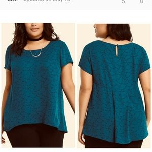 Torrid top green with small black shooting stars